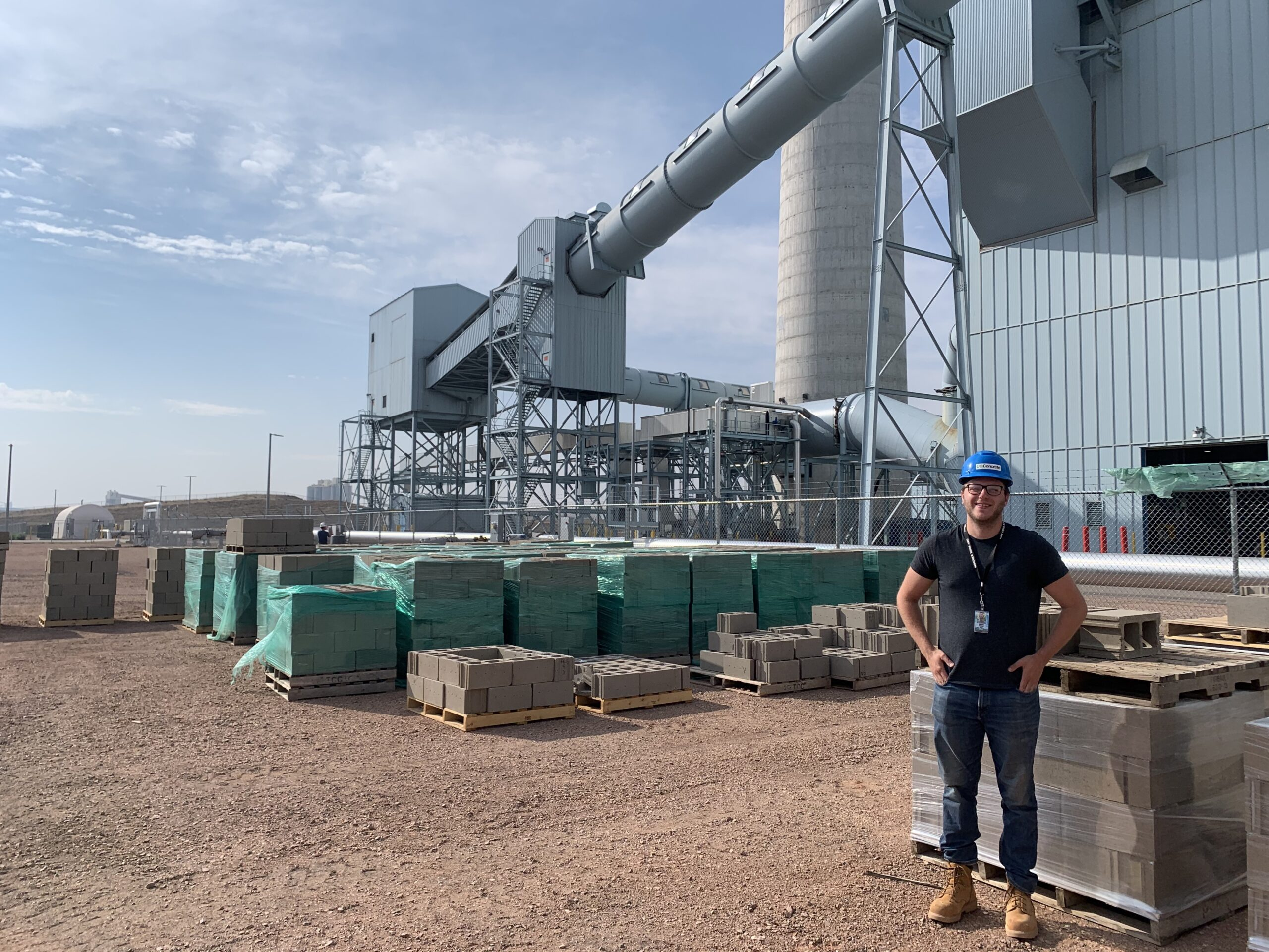 Gabe Falzone with the team CO2Concrete next to roughly 70 tons of concrete produced with CO2
